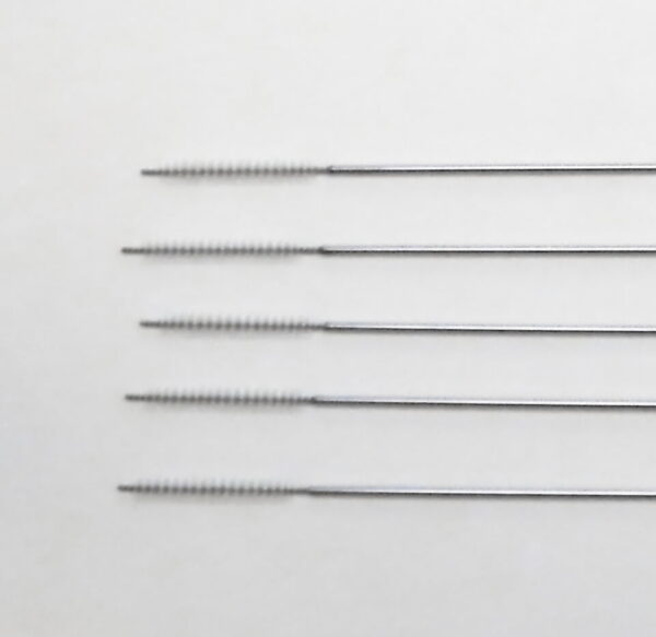 cleaning brushes for reusable needle guides