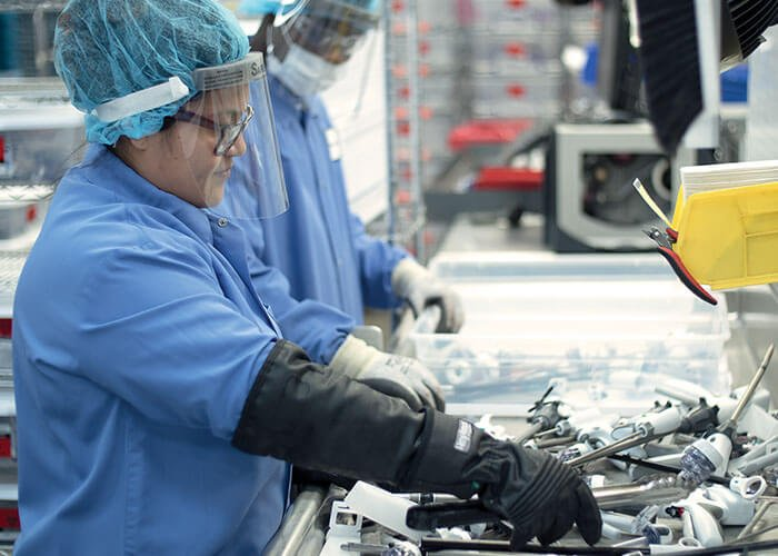 Employees reprocessing single-use medical devices for sustainability in healthcare